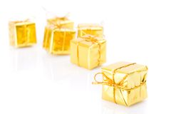 Golden gifts isolated on white Royalty Free Stock Images