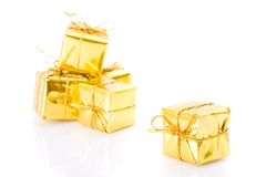 Golden gifts isolated on white Royalty Free Stock Image