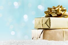 Golden gifts or presents boxes on magic bokeh background. Holiday composition for Christmas or New Year. royalty free stock images