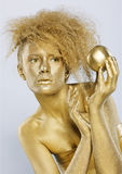 Golden girl with apple Stock Photo