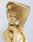 Golden girl with apple Royalty Free Stock Image