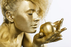 Golden girl with apple Royalty Free Stock Images