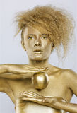Golden girl with apple Royalty Free Stock Photography