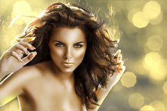The golden girl with golden nails Stock Photo