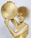 Golden girl with vinyl Royalty Free Stock Photography