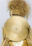 Golden girl with vinyl Royalty Free Stock Photos