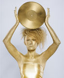 Golden girl with vinyl Stock Images