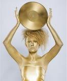 Golden girl with vinyl Stock Images