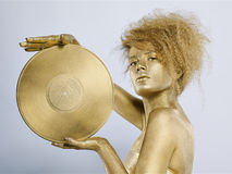 Golden girl with vinyl Royalty Free Stock Photo