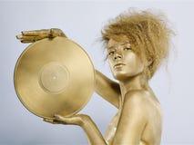 Golden girl with vinyl Royalty Free Stock Photo