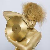 Golden girl with vinyl Stock Photo
