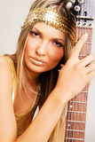 Golden Girl With Electric Guitar Stock Photo