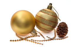 Golden glass spheres and christmas decoration Stock Photos
