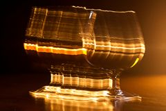 Golden glass of whiskey and yellow lines Stock Images