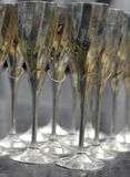Golden glasses. 12 old golden glasses on the table Royalty Free Stock Image
