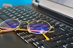 Golden glasses on laptop Royalty Free Stock Image