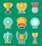 Golden and glassy trophy cups and awards set. Golden and glassy trophy cups and awards of different shape set isolated vector illustration. Winner championship Stock Photo