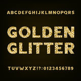 Golden glitter alphabet font. Bold letters numbers and symbols. Royalty Free Stock Photo