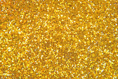 Golden glitter background. Closeup of the golden glitter background Royalty Free Stock Images