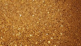 Golden glitter background glamorous sparkling wallpaper glamour royalty free stock photo