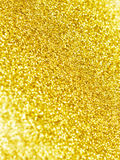 Golden glitter background. Gold defocused glitter texture for beautiful holiday background Royalty Free Stock Image