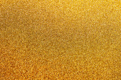Golden glitter background with little sparkles. Festive backdrop fot your text or design Stock Photography