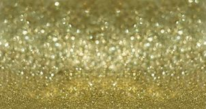 Golden glitter background. Selective focus on golden glitter background Royalty Free Stock Photos