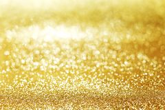 Golden glitter background Stock Image