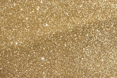Golden glitter blur Stock Images