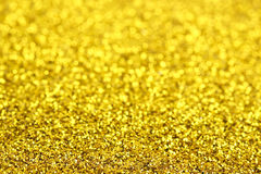 Golden glitter. With blurs for background use Royalty Free Stock Images
