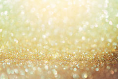 Golden glitter bokeh background. Shiny background. Stock Images