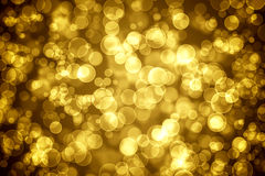 Golden glitter  bokeh holiday background Stock Images