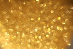 Golden glitter christmas abstract bokeh background. Blurred sparkles backdrop royalty free stock photos