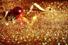 Golden glitter, Christmas ball and streamer stock photos