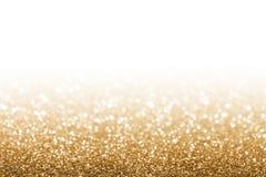 Golden glitter. Golden defocused glitter for new year background Stock Photos