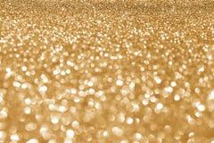 Golden glitter. Golden defocused glitter for new year background Stock Photo