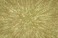 Golden glitter explosion lights abstract background Stock Images