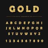 Golden glitter font on black background. Modern decorative alphabet for festive design. Glamour. Golden glitter font on black background. Modern decorative Stock Images