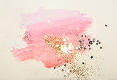 Golden glitter and glittering stars on abstract pink watercolor splash in vintage nostalgic colors. Golden glitter and glittering stars on abstract pink stock illustration