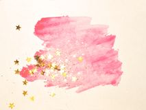 Golden glitter and glittering stars on abstract pink watercolor splash on white background. For your design stock illustration