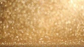 Golden glitter background stock video footage
