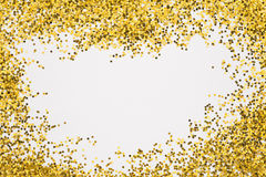 Golden glitter. Gold border. Sequins,Golden shine,Powder,Glitter Shining background Stock Photo