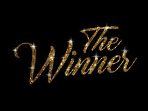 Golden glitter of  hand writing word THE WINNER. The golden glitter of  hand writing word  THE WINNER on black background Royalty Free Stock Image