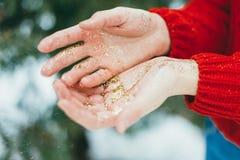 Golden glitter on hands stock image