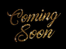 Golden glitter of isolated hand writing word COMING SOON Royalty Free Stock Photography