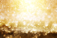 Golden glitter lights background. Abstract golden glitter lights background for a solemn occasion royalty free stock photo