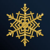 Golden glitter magnetic snowflake. Stock Photography