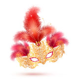 Golden glitter ornate carnival mask with bright red feathers isolated on white background Stock Photos