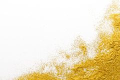 Golden glitter sand texture, abstract background. Golden glitter sand texture on white, abstract background. Yellow dusty shimmer decoration, shiny and stock photo