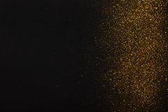 Golden glitter sand texture border on black, abstract background. Golden glitter sand texture border on black, abstract background with copy space. Yellow dusty royalty free stock image